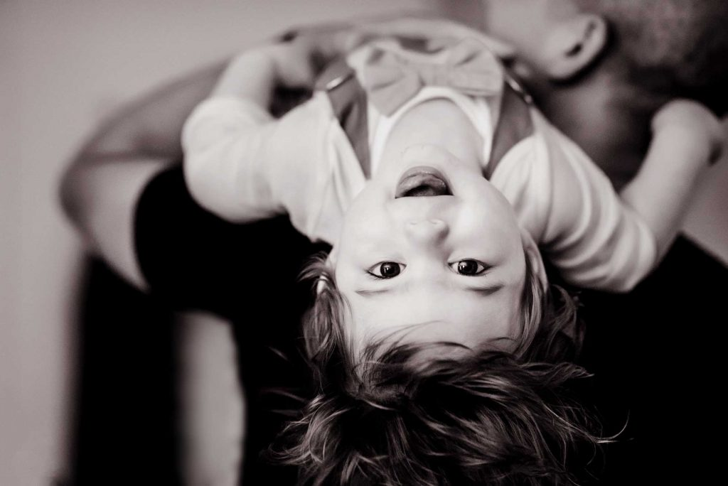 Boy upside down smiling